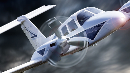 Close up of a private aircraft flying through stormy weather